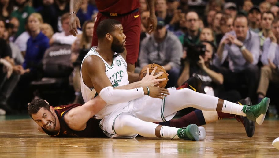 BOSTON, MA - MAY 15:  Kevin Love #0 of the Cleveland Cavaliers and Greg Monroe #55 of the Boston Celtics battle for the ball in the first half during Game Two of the 2018 NBA Eastern Conference Finals at TD Garden on May 15, 2018 in Boston, Massachusetts. NOTE TO USER: User expressly acknowledges and agrees that, by downloading and or using this photograph, User is consenting to the terms and conditions of the Getty Images License Agreement.  (Photo by Maddie Meyer/Getty Images)