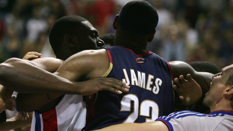 AUBURN HILLS, MI - MAY 31:  LeBron James #23 of the Cleveland Cavaliers is restrained by Jason Maxiell #54 of the Detroit Pistons as James walks towards Antonio McDyess #24 of the Pistons after McDyess committed a flaggrant #2 foul against  Anderson Varejao in the first quarter of Game Five of the Eastern Conference Finals during the 2007 NBA Playoffs at The Palace of Auburn Hills on May 31, 2007 in Auburn Hills, Michigan.  NOTE TO USER: User expressly acknowledges and agrees that, by downloading and or using this photograph, User is consenting to the terms and conditions of the Getty Images License Agreement.  (Photo by Matthew Stockman/Getty Images)