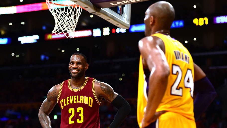 LOS ANGELES, CA - MARCH 10:  LeBron James #23 of the Cleveland Cavaliers jokes with Kobe Bryant #24 of the Los Angeles Lakers during a 120-108 Cavaliers win at Staples Center on March 10, 2016 in Los Angeles, California.  NOTE TO USER: User expressly acknowledges and agrees that, by downloading and or using this Photograph, user is consenting to the terms and condition of the Getty Images License Agreement.  (Photo by Harry How/Getty Images)