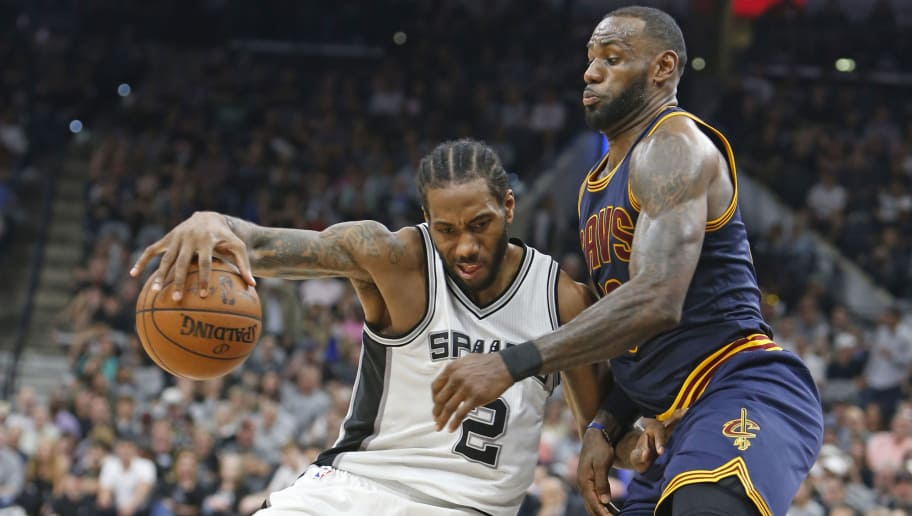 SAN ANTONIO,TX - MARCH 27:  Kawhi Leonard #2 of the San Antonio Spurs tries to drive on LeBron James #23 of the Cleveland Cavaliers at AT&T Center on March 27, 2017 in San Antonio, Texas.  NOTE TO USER: User expressly acknowledges and agrees that , by downloading and or using this photograph, User is consenting to the terms and conditions of the Getty Images License Agreement. (Photo by Ronald Cortes/Getty Images)