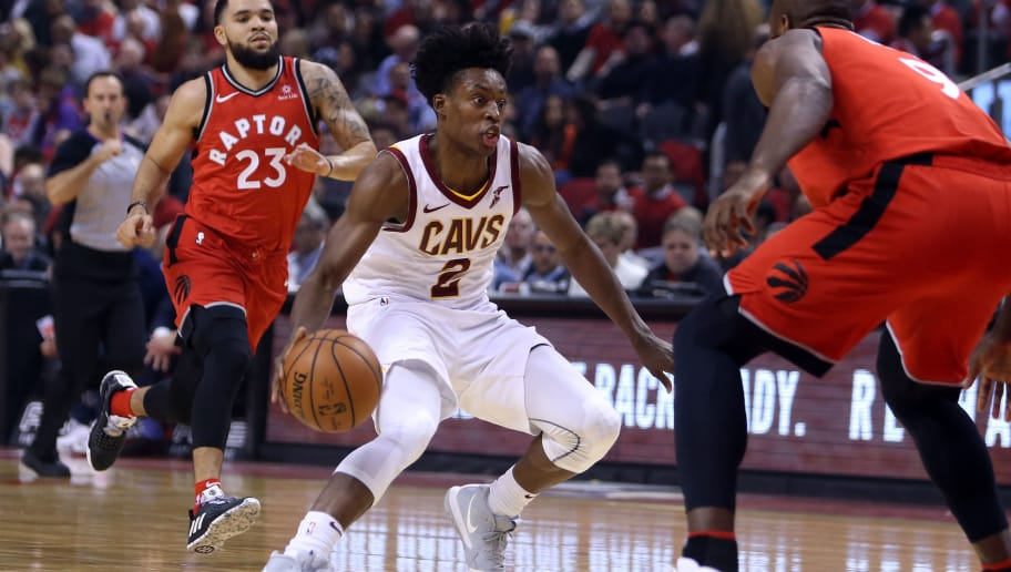 TORONTO, ON - OCTOBER 17:  Collin Sexton #2 of the Cleveland Cavaliers dribbles the ball as Serge Ibaka #9 of the Toronto Raptors defends in the first half of the NBA season opener at Scotiabank Arena on October 17, 2018 in Toronto, Canada.  NOTE TO USER: User expressly acknowledges and agrees that, by downloading and or using this photograph, User is consenting to the terms and conditions of the Getty Images License Agreement.  (Photo by Vaughn Ridley/Getty Images)