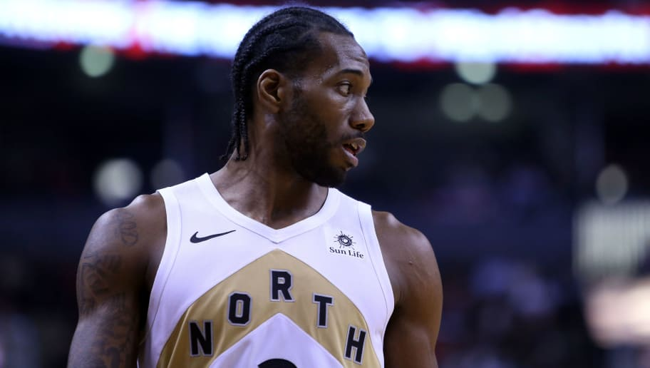 TORONTO, ON - DECEMBER 21:  Kawhi Leonard #2 of the Toronto Raptors looks on during the first half of an NBA game against the Cleveland Cavaliers at Scotiabank Arena on December 21, 2018 in Toronto, Canada.  NOTE TO USER: User expressly acknowledges and agrees that, by downloading and or using this photograph, User is consenting to the terms and conditions of the Getty Images License Agreement.  (Photo by Vaughn Ridley/Getty Images)