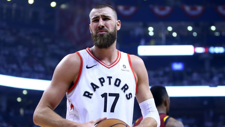 TORONTO, ON - MAY 03:  Jonas Valanciunas #17 of the Toronto Raptors reacts after fouling J.R. Smith #5 of the Cleveland Cavaliers in the first half of Game Two of the Eastern Conference Semifinals during the 2018 NBA Playoffs at Air Canada Centre on May 3, 2018 in Toronto, Canada.  NOTE TO USER: User expressly acknowledges and agrees that, by downloading and or using this photograph, User is consenting to the terms and conditions of the Getty Images License Agreement.  (Photo by Vaughn Ridley/Getty Images)