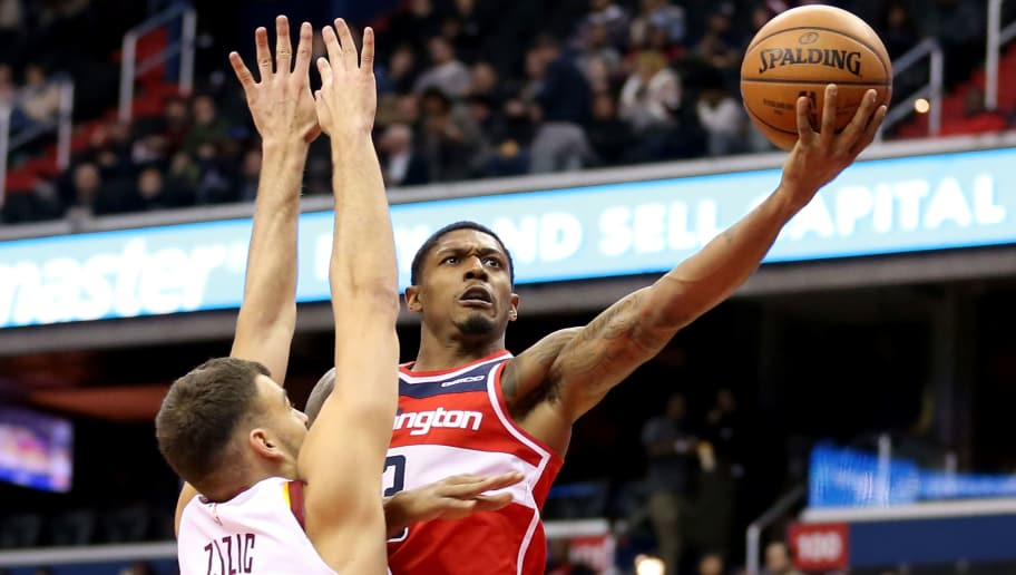 WASHINGTON, DC - NOVEMBER 14: Bradley Beal #3 of the Washington Wizards shoots past Ante Zizic #41 of the Cleveland Cavaliers during the second half at Capital One Arena on November 14, 2018 in Washington, DC. NOTE TO USER: User expressly acknowledges and agrees that, by downloading and or using this photograph, User is consenting to the terms and conditions of the Getty Images License Agreement. (Photo by Will Newton/Getty Images)