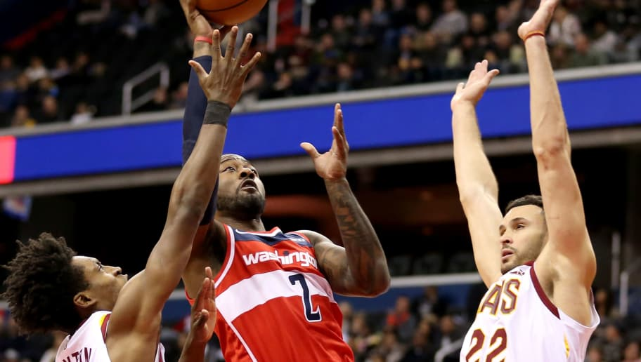 WASHINGTON, DC - NOVEMBER 14: John Wall #2 of the Washington Wizards shoots past Collin Sexton #2 and Larry Nance Jr. #22 of the Cleveland Cavaliers during the second half at Capital One Arena on November 14, 2018 in Washington, DC. NOTE TO USER: User expressly acknowledges and agrees that, by downloading and or using this photograph, User is consenting to the terms and conditions of the Getty Images License Agreement. (Photo by Will Newton/Getty Images)