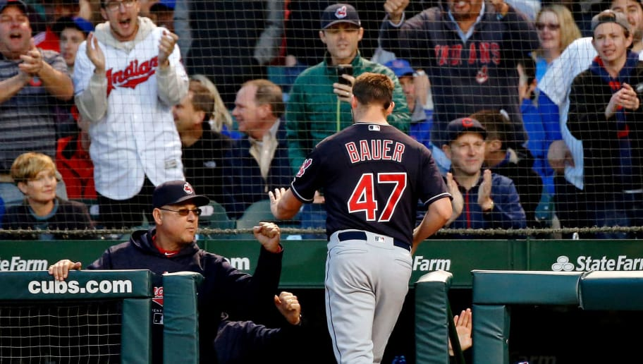 CHICAGO, IL - MAY 22: Trevor Bauer #47 of the Cleveland Indians is greeted at the stairs of the dugout after scoring against the Chicago Cubs on an three-run RBI double hit by Yonder Alonso #17 (not pictured) during the fifth inning at Wrigley Field on May 22, 2018 in Chicago, Illinois.  (Photo by Jon Durr/Getty Images)