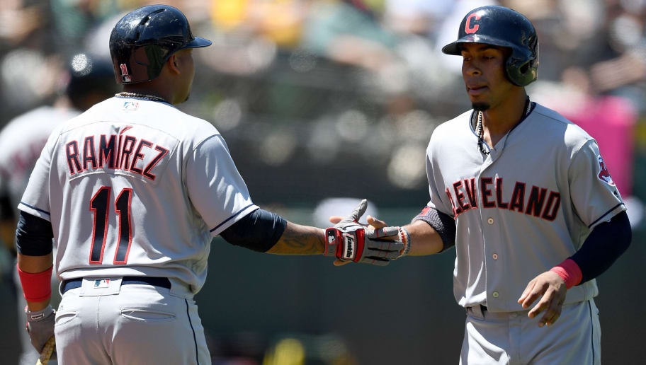 OAKLAND, CA - JULY 16:  Francisco Lindor #12 of the Cleveland Indians is congratulated by Jose Ramirez #11 after Linfor scored against the Oakland Athletics in the top of the fouth inning at Oakland Alameda Coliseum on July 16, 2017 in Oakland, California.  (Photo by Thearon W. Henderson/Getty Images)