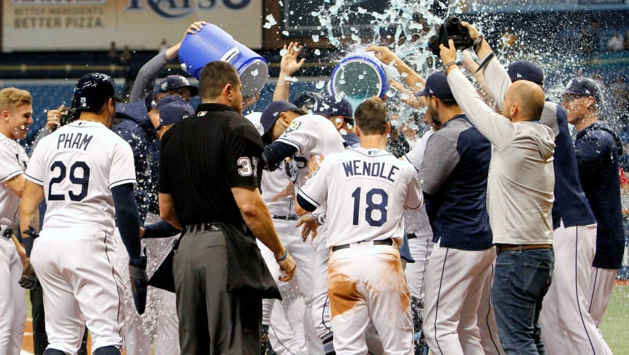 ST. PETERSBURG, FL  SEPTEMBER 10: Ji-Man Choi #26 of the Tampa Bay Rays is surrounded by teammates and showered with ice and Gatorade after reaching home plate. Choi hit a two-run home run in the ninth inning of the game against the Cleveland Indians at Tropicana Field on September 10, 2018 in St. Petersburg, Florida. (Photo by Joseph Garnett Jr./Getty Images)