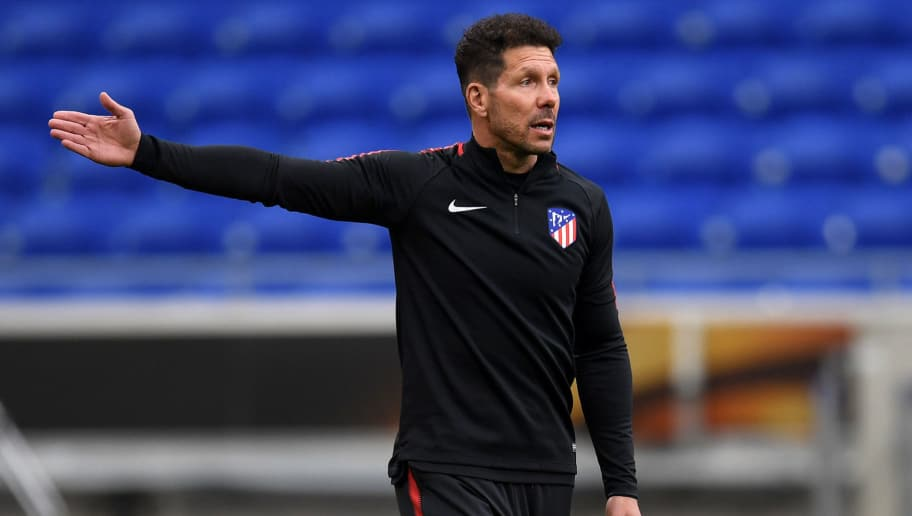 LYON, FRANCE - MAY 15:  Diego Simeone, Coach of Atletico Madrid gives instruction to his team during a Club Atletico de Madrid training session ahead of the the UEFA Europa League Final against Olympique de Marseille at Stade de Lyon on May 15, 2018 in Lyon, France.  (Photo by Matthias Hangst/Getty Images)