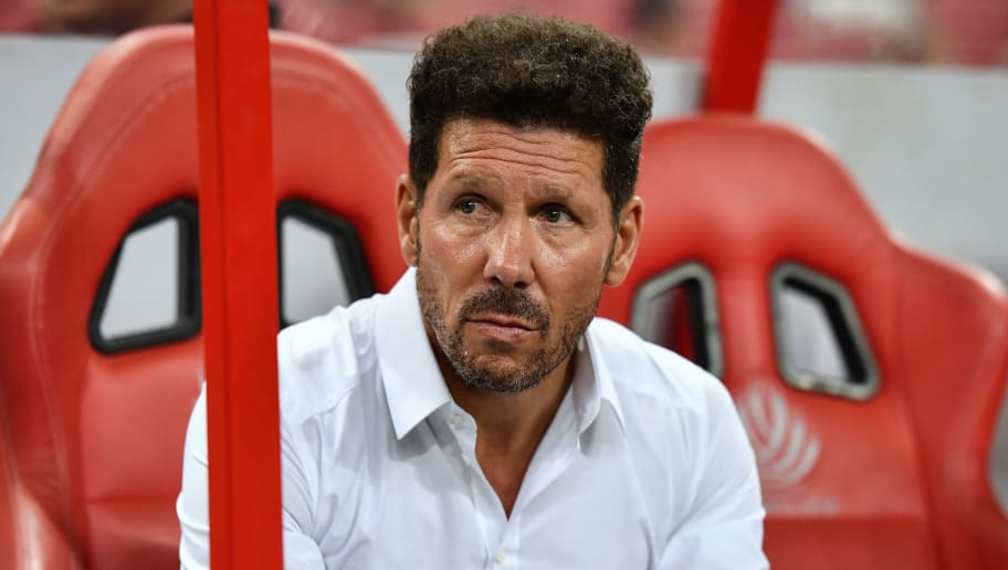 SINGAPORE - JULY 26: Diego Simeone team manager of Atletico Madrid looks during the International Champions Cup 2018 match between Club Atletico de Madrid and Arsenal at the National Stadium on July 26, 2018 in Singapore.  (Photo by Thananuwat Srirasant/Getty Images for ICC)
