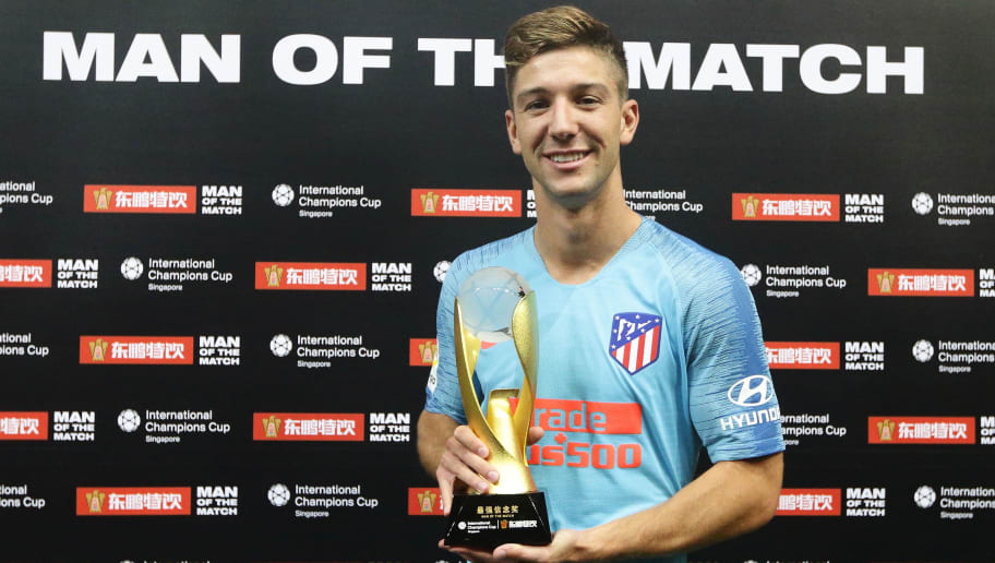SINGAPORE - JULY 26:  Luciano Vietto of Atletico Madrid is named Man of the Match during the International Champions Cup 2018 match between Atletico Madrid and Arsenal at the National Stadium on July 26, 2018 in Singapore.  (Photo by Suhaimi Abdullah/Getty Images for ICC)