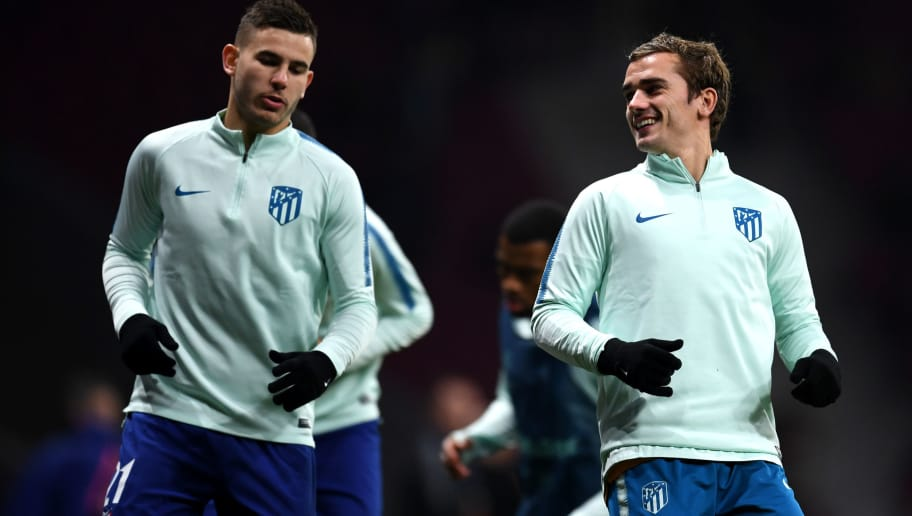MADRID, SPAIN - NOVEMBER 28:  Antoine Griezmann (R) and Lucas Hernandez of Atletico Madrid (L) warm up prior to the UEFA Champions League Group A match between Club Atletico de Madrid and AS Monaco at Estadio Wanda Metropolitano on November 28, 2018 in Madrid, Spain.  (Photo by David Ramos/Getty Images)