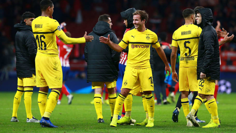 MADRID, SPAIN - NOVEMBER 06:  Mario Gotze of Borussia Dortmund and Manuel Akanji of Borussia Dortmund celebrate following their sides victory in the Group A match of the UEFA Champions League between Club Atletico de Madrid and Borussia Dortmund at Estadio Wanda Metropolitano on November 6, 2018 in Madrid, Spain.  (Photo by Gonzalo Arroyo Moreno/Getty Images)