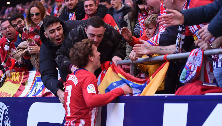 MADRID, SPAIN - DECEMBER 08:  Antoine Griezmann of Atletico Madrid celebrates after scoring his team's second goal with the fans during the La Liga match between Club Atletico de Madrid and Deportivo Alaves at Wanda Metropolitano on December 8, 2018 in Madrid, Spain (Photo by Denis Doyle/Getty Images)
