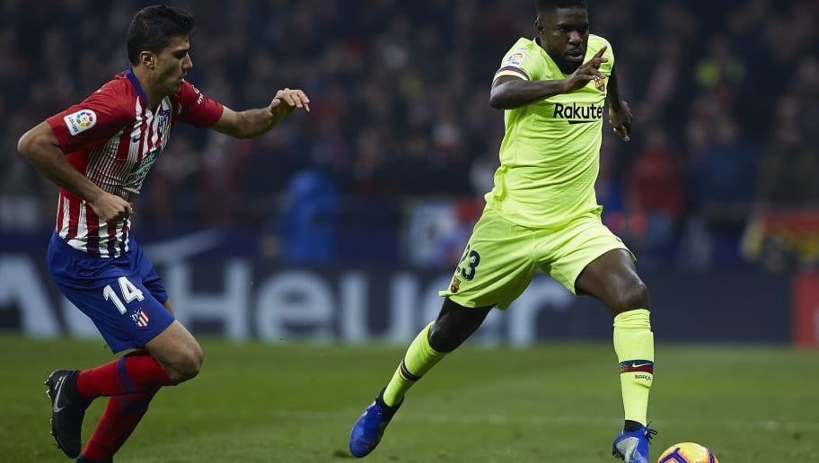 MADRID, SPAIN - NOVEMBER 24:  Samuel Umtiti of FC Barcelona competes for the ball with Rodrigo Hernandez of Atletico de Madrid during the La Liga match between Club Atletico de Madrid and FC Barcelona at Wanda Metropolitano on November 24, 2018 in Madrid, Spain.  (Photo by Quality Sport Images/Getty Images)