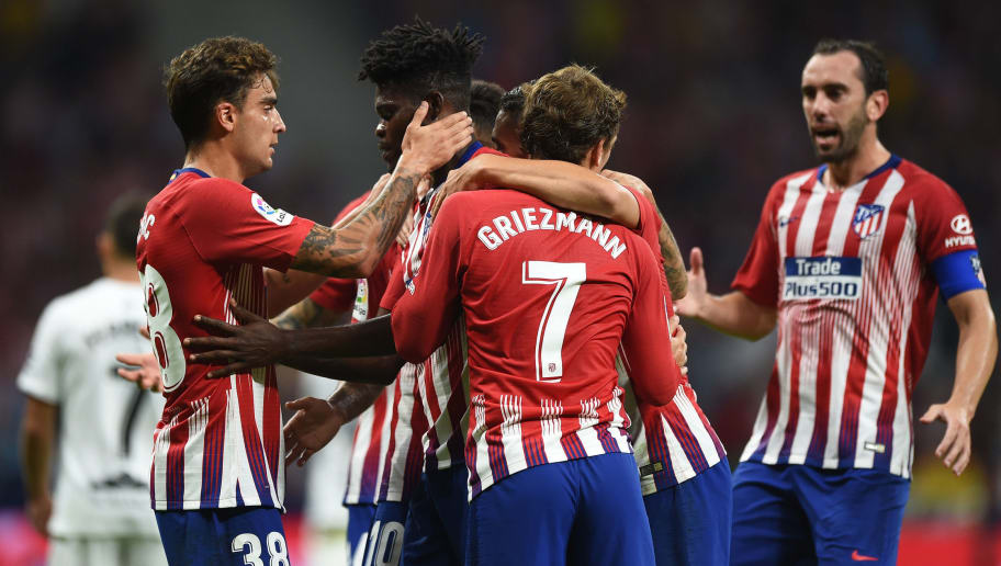 MADRID, SPAIN - SEPTEMBER 25:  Thomas Lemar (2.L) of Club Atletico de Madrid celebrates with teammates after scoring his team's 2nd goal during the La Liga match between Club Atletico de Madrid and SD Huesca at Wanda Metropolitano on September 25, 2018 in Madrid, Spain. (Photo by Denis Doyle/Getty Images)