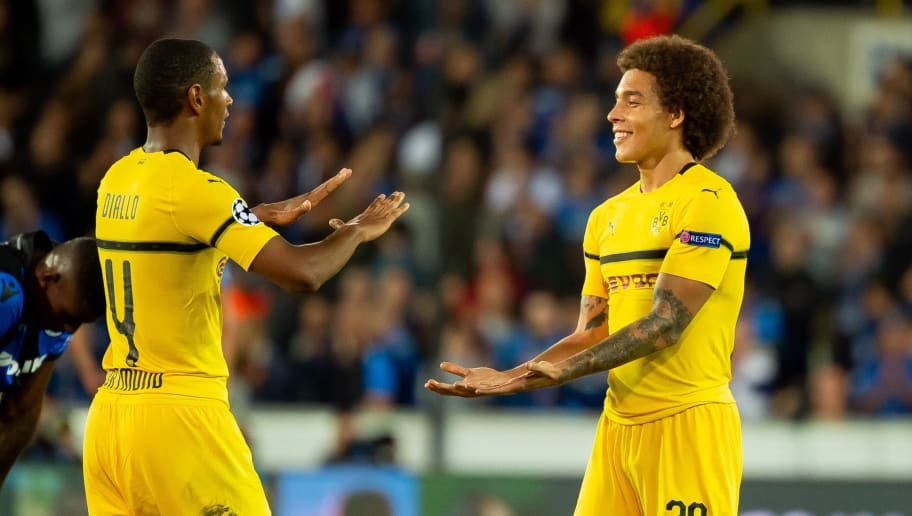 BRUGGE, BELGIUM - SEPTEMBER 18: Abdou Diallo of Borussia Dortmund and Axel Witsel of Borussia Dortmund celebrate after winning the UEFA Champions League Group A match between Club Brugge and Borussia Dortmund at Jan Breydel Stadium on September 18, 2018 in Brugge, Belgium. (Photo by TF-Images/Getty Images)