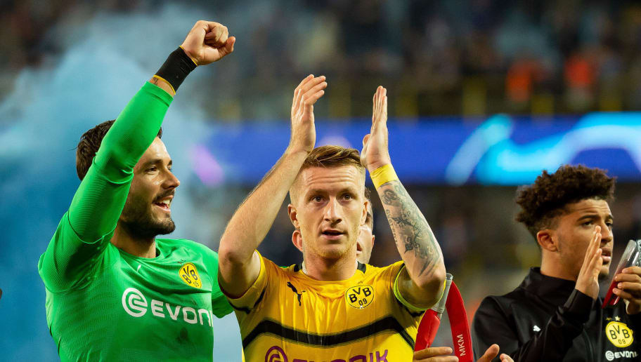 BRUGGE, BELGIUM - SEPTEMBER 18: Goalkeeper Roman Buerki of Borussia Dortmund and Marco Reus of Borussia Dortmund celebrate after winning the UEFA Champions League Group A match between Club Brugge and Borussia Dortmund at Jan Breydel Stadium on September 18, 2018 in Brugge, Belgium. (Photo by TF-Images/Getty Images)