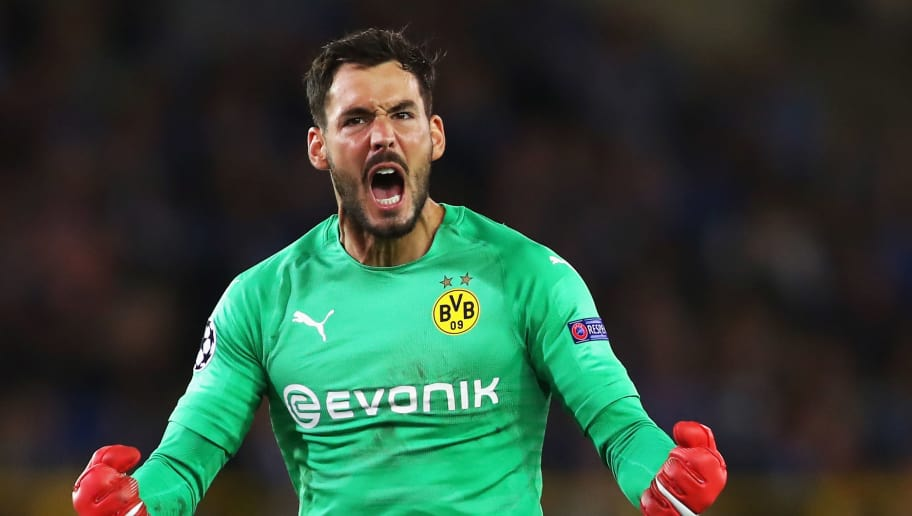BRUGGE, BELGIUM - SEPTEMBER 18:  Goalkeeper, Roman Burki of Borussia Dortmund celebrates his team scoring a goal during the Group A match of the UEFA Champions League between Club Brugge and Borussia Dortmund at Jan Breydel Stadium on September 18, 2018 in Brugge, Belgium.  (Photo by Dean Mouhtaropoulos/Getty Images)