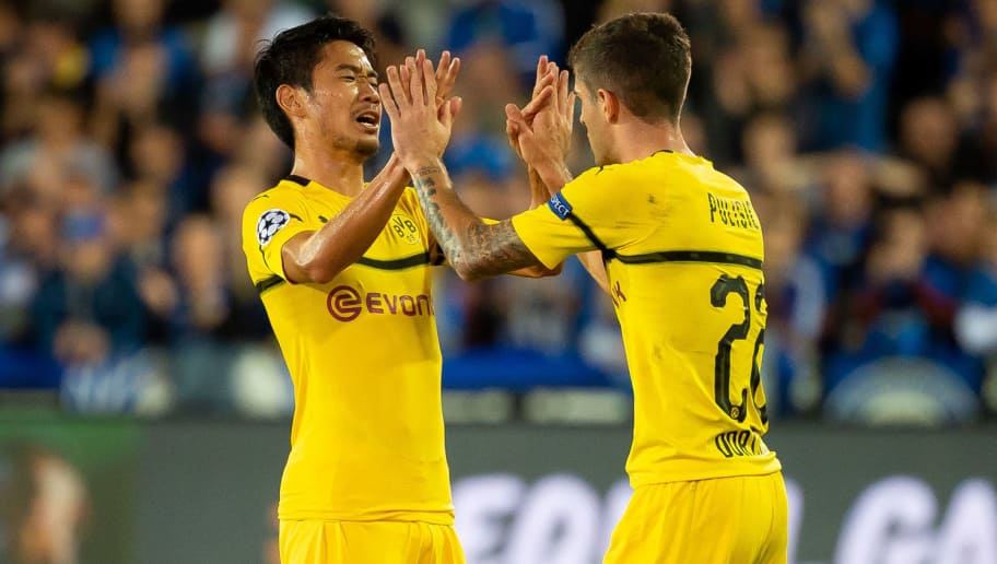 BRUGGE, BELGIUM - SEPTEMBER 18: Shinji Kagawa of Borussia Dortmund and Christian Pulisic of Borussia Dortmund celebrate after winning the UEFA Champions League Group A match between Club Brugge and Borussia Dortmund at Jan Breydel Stadium on September 18, 2018 in Brugge, Belgium. (Photo by TF-Images/Getty Images)