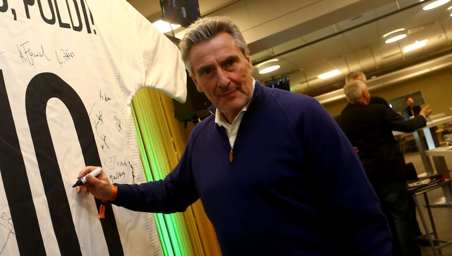 DORTMUND, GERMANY - MARCH 22:  Dieter Mueller signs a jersey of Lukas Podolski during the Club of Former National Players Meeting at Signal Iduna Park on March 22, 2017 in Dortmund, Germany.  (Photo by Christof Koepsel/Bongarts/Getty Images)