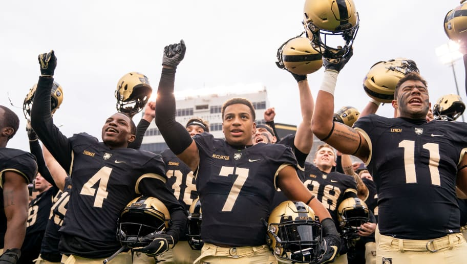 WEST POINT, NY - NOVEMBER 17: Cam Thomas #4, Jaylon McClinton #7, and Donavan Lynch #11 of the Army Black Knights sing the alma mater after winning a game against the Colgate Raiders at Michie Stadium on November 17, 2018 in West Point, New York. (Photo by Dustin Satloff/Getty Images)