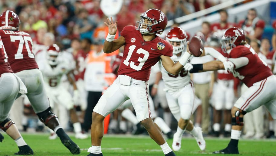 MIAMI, FL - DECEMBER 29: Tua Tagovailoa #13 of the Alabama Crimson Tide looks to pass in the fourth quarter during the College Football Playoff Semifinal against the Oklahoma Sooners at the Capital One Orange Bowl at Hard Rock Stadium on December 29, 2018 in Miami, Florida.  (Photo by Michael Reaves/Getty Images)