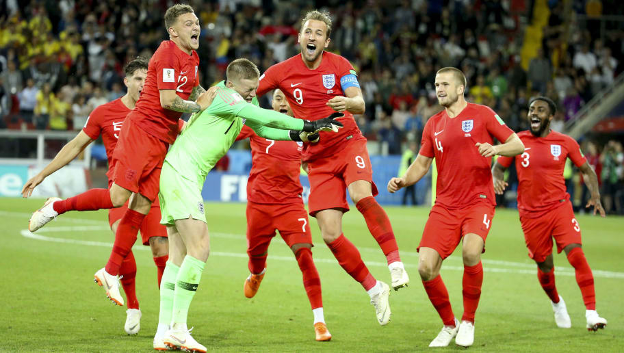 MOSCOW, RUSSIA - JULY 3: Goalkeeper of England Jordan Pickford is celebrated by teammates Kieran Trippier, Harry Kane, Eric Dier, Danny Rose of England after winning the penalty shootout of the 2018 FIFA World Cup Russia Round of 16 match between Colombia and England at Spartak Stadium on July 3, 2018 in Moscow, Russia. (Photo by Jean Catuffe/Getty Images)