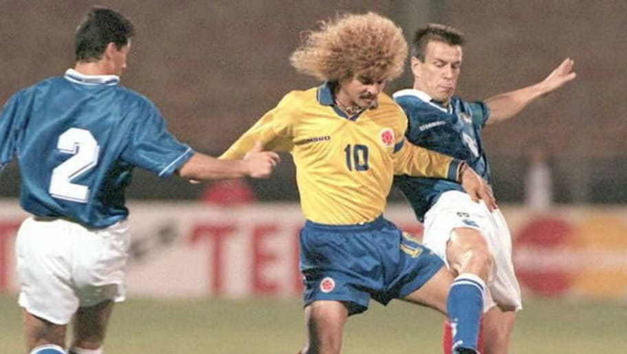 Colombian soccer player Carlos Valderrama (C) and