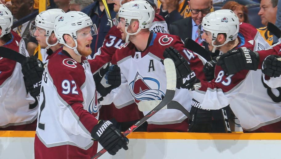 NASHVILLE, TN - APRIL 20:  Gabriel Landeskog #92 of the Colorado Avalanche is congratulated by teammates after scoring a goal during the third period of a 2-1 Avalanche victory in Game Five of the Western Conference First Round during the 2018 NHL Stanley Cup Playoffs at Bridgestone Arena on April 20, 2018 in Nashville, Tennessee.  (Photo by Frederick Breedon/Getty Images)