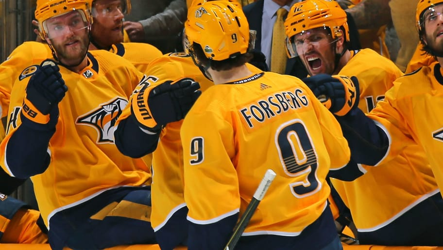 NASHVILLE, TN - APRIL 12:  Mattias Ekholm #14 and Mike Fisher #12 celebrate with teammate Filip Forsberg #9 of the Nashville Predators Forsberg's second goal of the game against the Colorado Avalanche during the third period of a 5-2 Predators victory in Game One of the Western Conference First Round during the 2018 NHL Stanley Cup Playoffs at Bridgestone Arena on April 12, 2018 in Nashville, Tennessee.  (Photo by Frederick Breedon/Getty Images)