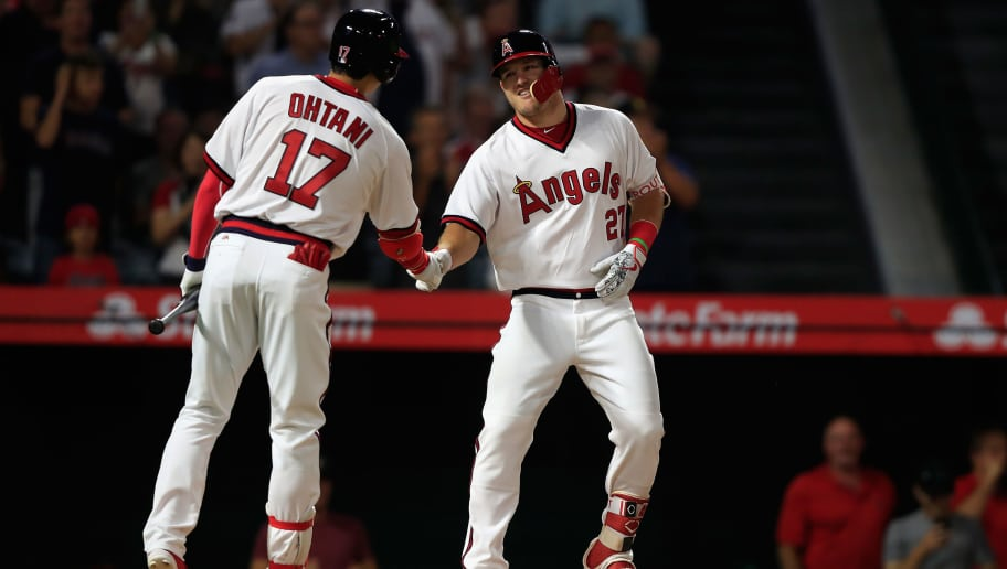 ANAHEIM, CA - AUGUST 27:  Shohei Ohtani #17 congratulates Mike Trout #27 of the Los Angeles Angels of Anaheim after his solo homerun during the sixth inning of a game against the Colorado Rockies at Angel Stadium on August 27, 2018 in Anaheim, California.  (Photo by Sean M. Haffey/Getty Images)
