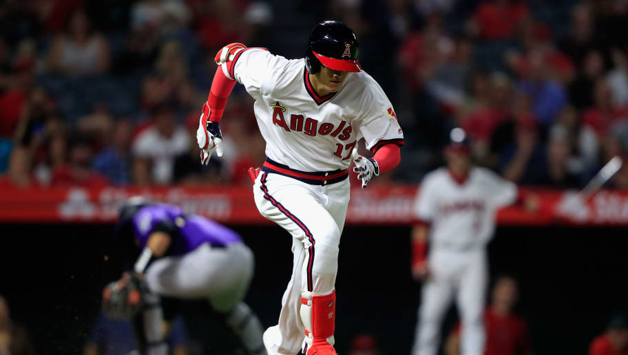 ANAHEIM, CA - AUGUST 28:  Shohei Ohtani #17 of the Los Angeles Angels of Anaheim runs to first base after a dropped strike three as Chris Iannetta #22 of the Colorado Rockies chases the ball during the ninth inning of a game at Angel Stadium on August 28, 2018 in Anaheim, California.  (Photo by Sean M. Haffey/Getty Images)