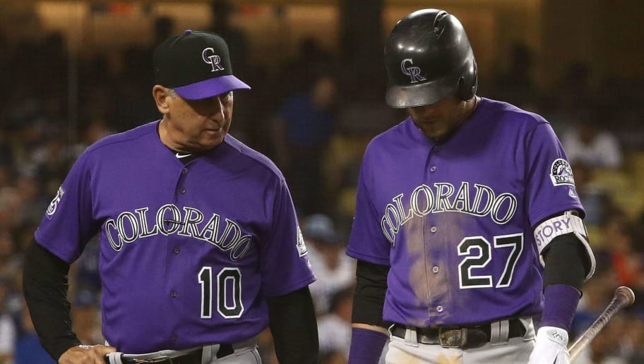 LOS ANGELES, CA - SEPTEMBER 17: Manager Bud Black #10 of the Colorado Rockies walks with Trevor Story #27 back to the dugout after Story left his at-bat injured and replaced by Pat Valaika #4 (not in photo) during the fourth inning of the MLB game against the Los Angeles Dodgers at Dodger Stadium on September 17, 2018 in Los Angeles, California.  (Photo by Victor Decolongon/Getty Images)
