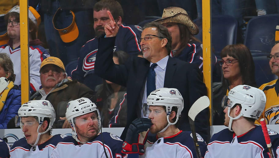 NASHVILLE, TN - APRIL 07:  Head coach John Tortorella of the Columbus Blue Jackets points to the jumbotron in protest after giving up a goal to the Nashville Predators with one second left in the first period at Bridgestone Arena on April 7, 2018 in Nashville, Tennessee.  (Photo by Frederick Breedon/Getty Images)
