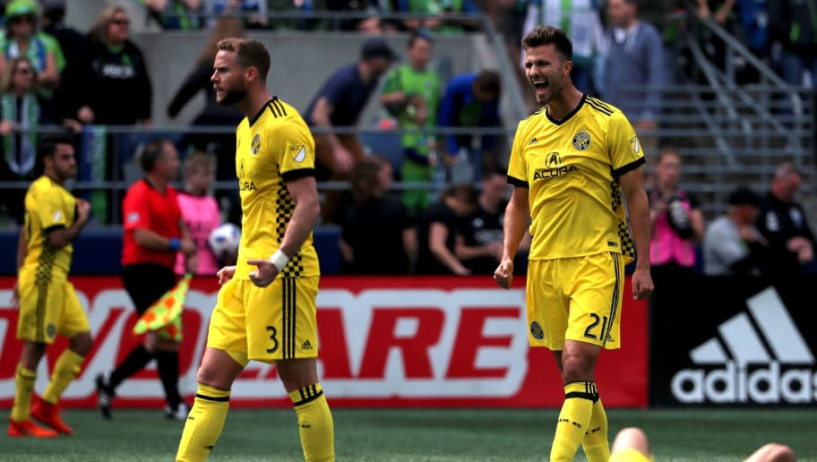 SEATTLE, WA - MAY 05: Josh Williams #3 and Alex Crognale #21 of Columbus Crew celebrate following their 0-0 draw to the Seattle Sounders during their game at CenturyLink Field on May 5, 2018 in Seattle, Washington.  (Photo by Abbie Parr/Getty Images)