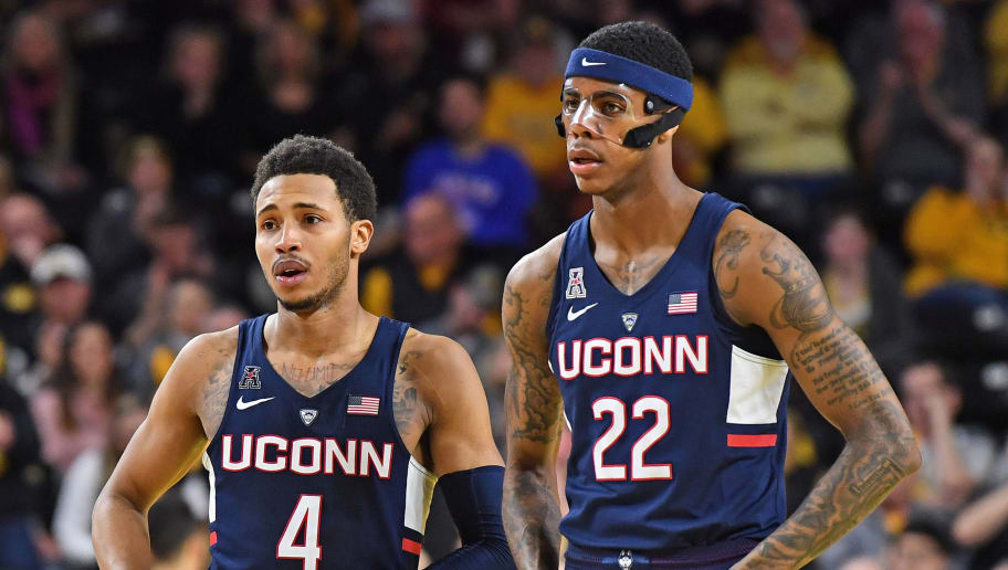 WICHITA, KS - FEBRUARY 10:  Jalen Adams #4 of the Connecticut Huskies talks with teammate Terry Larrier #22 during a stop of play in the second half against the Wichita State Shockers on February 10, 2018 at Charles Koch Arena in Wichita, Kansas.  (Photo by Peter G. Aiken/Getty Images)