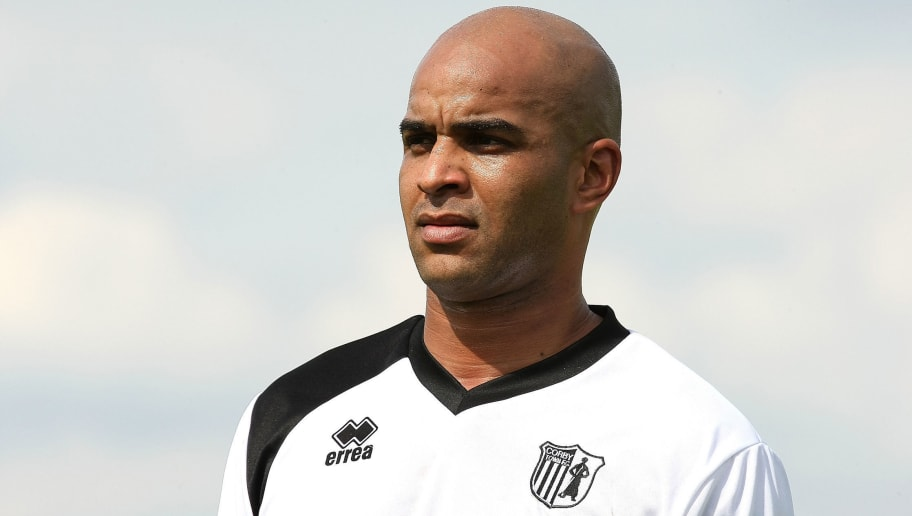 CORBY, ENGLAND - JULY 21:  Leon McKenzie of Corby Town in action during the Pre- Season Friendly between Corby Town and Northampton Town at Steel Park on July 21, 2012 in Corby, England.  (Photo by Pete Norton/Getty Images)