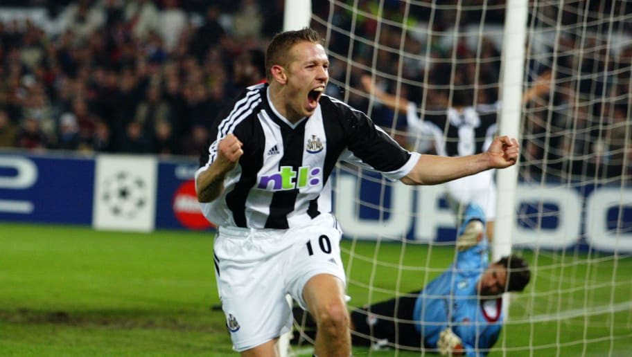 ROTTERDAM - NOVEMBER 13:  Craig Bellamy of Newcastle United celebrates after scoring the winning goal during the UEFA Champions League First Phase Group E match between Feyenoord and Newcastle United on November 13, 2002 played at the De Kuip Stadium in Rotterdam, Holland. Newcastle United won the match 3-2. (Photo by Stu Forster/Getty Images)