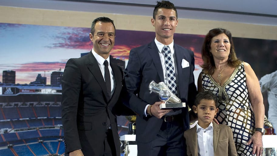 MADRID, SPAIN - OCTOBER 02:  Cristiano Ronaldo (2ndL) poses for a picture with his trophy as all-time top scorer of of Real Madrid CF with his son Cristiano Ronald JR, mother Maria Dolores dos Santos and his manager Jorge Mendes (L) at Honour box-seat of Santiago Bernabeu  Stadium on October 2, 2015 in Madrid, Spain. Portuguese palyer Cristiano Ronaldo overtook on his last UEFA Champions League match against Malmo FF Raul's  record as Real Madrid all-time top scorer.  (Photo by Gonzalo Arroyo Moreno/Getty Images)