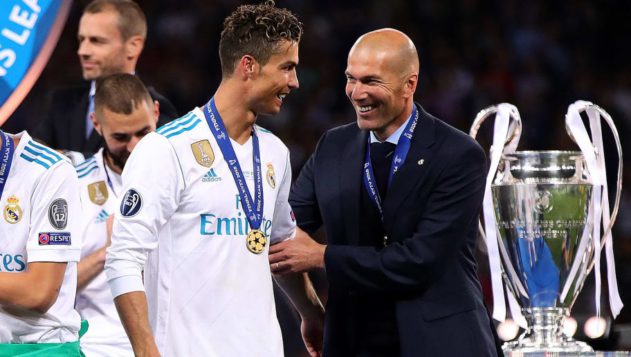 KIEV, UKRAINE - MAY 26: Real Madrid manager Zinedine Zidane embraces Cristiano Ronaldo following the UEFA Champions League final between Real Madrid and Liverpool at the NSC Olimpiyskiy on May 26, 2018 in Kiev, Ukraine. (Photo by Chris Brunskill Ltd/Getty Images)