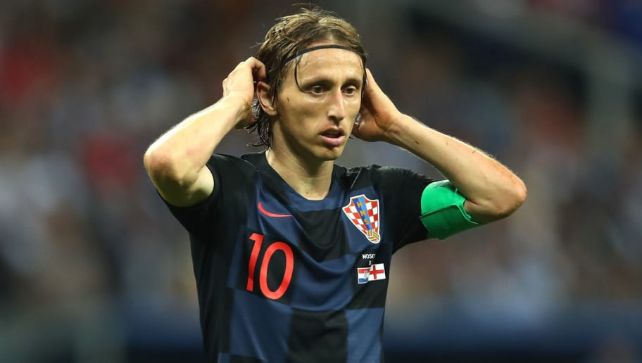 MOSCOW, RUSSIA - JULY 11:  Luka Modric of Croatia reacts in extra time during the 2018 FIFA World Cup Russia Semi Final match between Croatia and England at Luzhniki Stadium on July 11, 2018 in Moscow, Russia. (Photo by Robbie Jay Barratt - AMA/Getty Images)