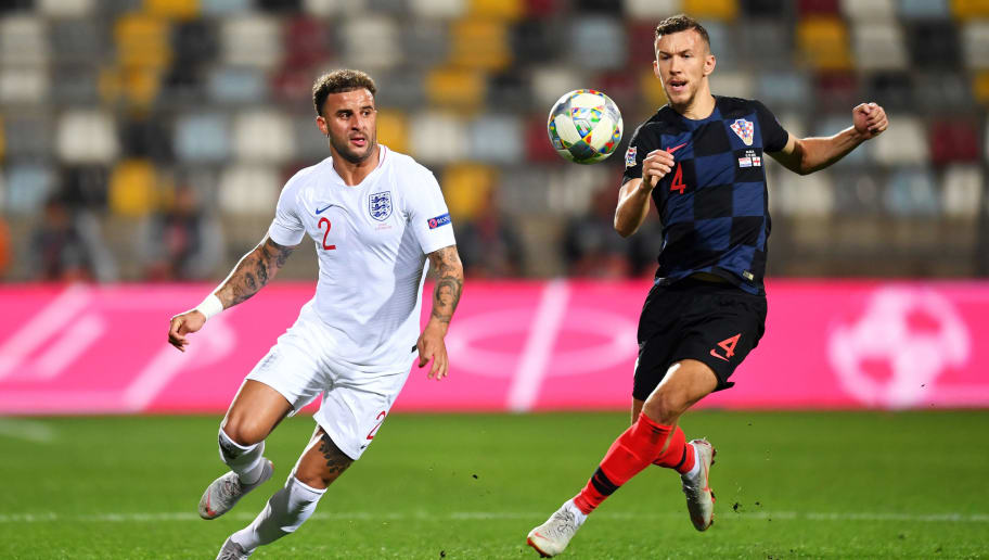 RIJEKA, CROATIA - OCTOBER 12:  Kyle Walker of England watches the ball with Ivan Perisic of Croatia during the UEFA Nations League A Group Four match between Croatia and England at Stadion HNK Rijeka on October 12, 2018 in Rijeka, Croatia. The match is due to be played behind closed doors.  (Photo by Michael Regan/Getty Images)