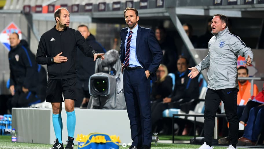 RIJEKA, CROATIA - OCTOBER 12:  Gareth Southgate, Manager of England and Steve Holland assistant Manager of England react during the UEFA Nations League A Group Four match between Croatia and England at Stadion HNK Rijeka on October 12, 2018 in Rijeka, Croatia. The match is due to be played behind closed doors.  (Photo by Michael Regan/Getty Images)