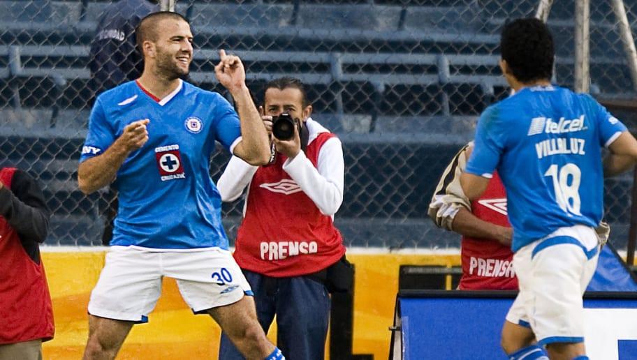 Cruz Azul's Emmanuel Villa (L) celebrate