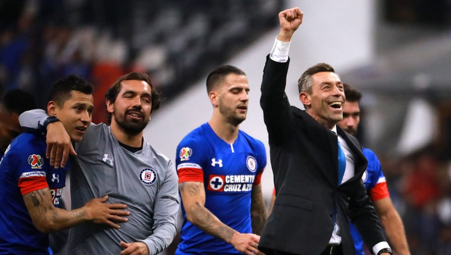 MEXICO CITY, MEXICO - DECEMBER 08: Pedro Caixinha, coach of Cruz Azul celebrates after winning the semifinal second leg match between Cruz Azul and Monterrey as part of the Torneo Apertura 2018 Liga MX at Azteca Stadium on December 08, 2018 in Mexico City, Mexico. (Photo by Manuel Velasquez/Getty Images)