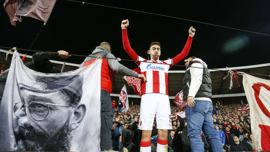BELGRADE, SERBIA - NOVEMBER 06: Milan Pavkov (C) of Crvena Zvezda celebrates victory with supporters after the Group C match of the UEFA Champions League between Red Star Belgrade and Liverpool at Rajko Mitic Stadium on November 06, 2018 in Belgrade, Serbia. (Photo by Srdjan Stevanovic/Getty Images)