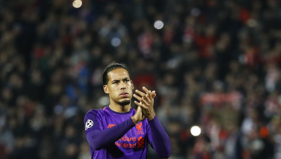 BELGRADE, SERBIA - NOVEMBER 06: Virgil Van Dijk of Liverpool applauded to supporters after the Group C match of the UEFA Champions League between Red Star Belgrade and Liverpool at Rajko Mitic Stadium on November 06, 2018 in Belgrade, Serbia. (Photo by Srdjan Stevanovic/Getty Images)
