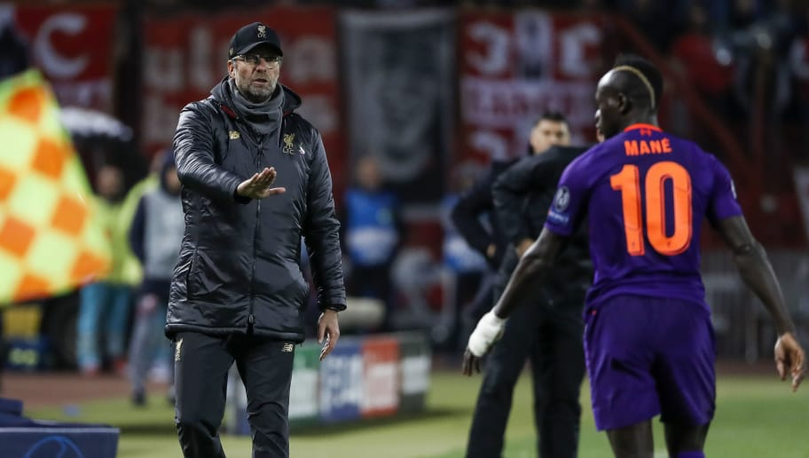 BELGRADE, SERBIA - NOVEMBER 06: Manager Jurgen Klopp (L) speaks with Sadio Mane (R) of Liverpool during the Group C match of the UEFA Champions League between Red Star Belgrade and Liverpool at Rajko Mitic Stadium on November 06, 2018 in Belgrade, Serbia. (Photo by Srdjan Stevanovic/Getty Images)