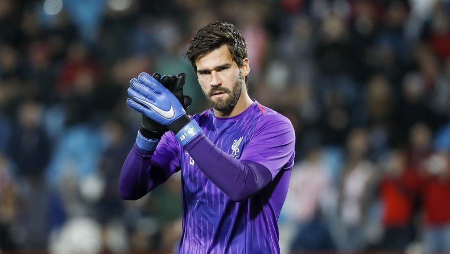 BELGRADE, SERBIA - NOVEMBER 06: Alisson Becker of Liverpool warm-up prior to the Group C match of the UEFA Champions League between Red Star Belgrade and Liverpool at Rajko Mitic Stadium on November 06, 2018 in Belgrade, Serbia. (Photo by Srdjan Stevanovic/Getty Images)
